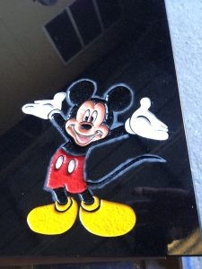 Coloured Mickey mouse engraving on a headstone