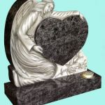 Beautiful carved angel holding a heart headstone