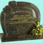 memorial with curved borders and two raised hearts