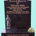 Black Headstone with religious engraving