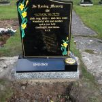 headstone with daffodils